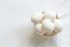 Bowl full of white eggs on a white tablecloth Royalty Free Stock Photo