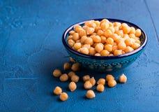 Bowl of garbanzo beans. Boiled garbanzo beans in a bowl stock photo