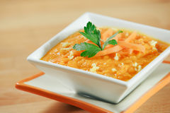 Bowl of ginger carrot soup Stock Photos