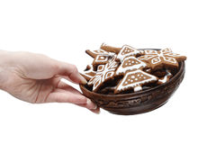 Bowl of gingerbread cookies in beautiful hand Stock Images