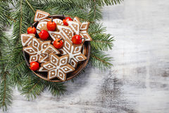 Bowl of gingerbread cookies on fir branches. Stock Photo