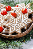 Bowl of gingerbread cookies on fir branches. Royalty Free Stock Images