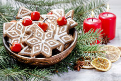 Bowl of gingerbread cookies on fir branches. Royalty Free Stock Photography