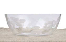 Bowl of glass on linen Royalty Free Stock Photo