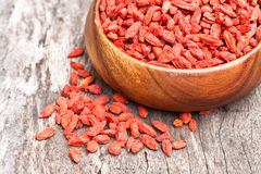 Bowl of goji berries on  wooden table Royalty Free Stock Photography