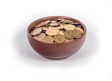 Bowl with gold coins Stock Images