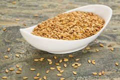 Bowl of gold flax seeds Stock Image