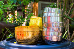 Bowl of gold and silver bowl. Royalty Free Stock Photography