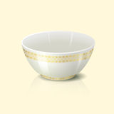 Bowl with golden floral ornament and reflection Stock Photography