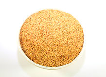 A bowl of golden linseed Royalty Free Stock Images