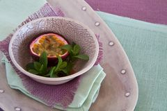 Bowl of granadilla on colorful linen Stock Image