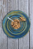 Bowl of granola on colorful placemat Royalty Free Stock Photo