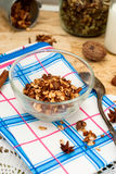 Bowl of granola oatmeal with walnuts and honey in a jar, a bottl Stock Photo