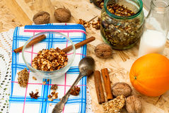 Bowl of granola oatmeal with walnuts and honey in a jar, a bottl Royalty Free Stock Image