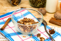 Bowl of granola oatmeal with walnuts and honey in a jar, a bottl Stock Photography