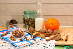 Bowl of granola oatmeal with walnuts and honey in a jar, a bottl Stock Photos