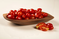 A bowl of grape tomatoes over a white background Royalty Free Stock Images