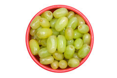 Bowl of grapes. A bowl of fresh green grapes isolated on a white background stock photos