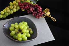 Bowl of Grapes on Black Background Stock Photos