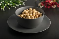 Bowl gray with hazelnuts royalty free stock photography