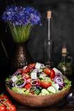 Bowl with Greek salad, still life Stock Photos