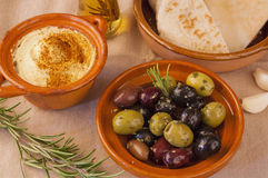 Bowl of olives with hummus and pita bread Royalty Free Stock Photo