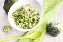 Bowl of green broccoli and cucumber salad Stock Photo