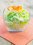 Bowl of green cabbage salad decorated with carrot. Royalty Free Stock Photo