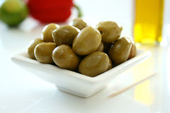 Bowl of Green Olives 1. A white bowl containing fresh green olives royalty free stock image