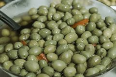 Bowl of green olives stock image