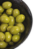 Bowl of green olives isolated. Bowl of olives isolated on white, close up stock photography