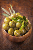 Bowl with green olives Stock Photos