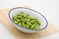 Bowl of green peas. Bowl of fresh green peas isolated on white Stock Photo