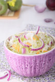 Bowl of green radish salad with sauerkraut Royalty Free Stock Photo