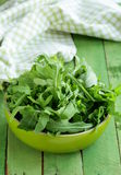Bowl of green salad with arugula Stock Photo