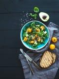 Bowl of green salad with avocado, arugula, cherry Royalty Free Stock Photos