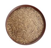 Bowl of ground black pepper isolated on white. Top view stock photos