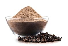 Bowl of ground black pepper on white background Royalty Free Stock Photos