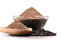 Bowl of ground black pepper on white background Royalty Free Stock Photography