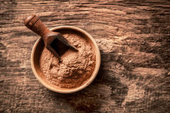 Bowl of ground cinnamon powder Royalty Free Stock Images