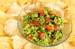Bowl of Guacamole on a bed of tortilla chips Royalty Free Stock Photography