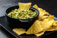 Bowl of guacamole with corn chips Stock Image