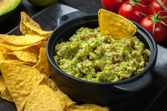 Bowl of guacamole with corn chips Stock Photo
