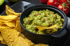 Bowl of guacamole with corn chips Royalty Free Stock Images