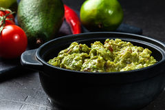 Bowl of guacamole with fresh ingredients Royalty Free Stock Image