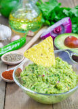 Bowl with guacamole with ingredients on backgroung Royalty Free Stock Photography