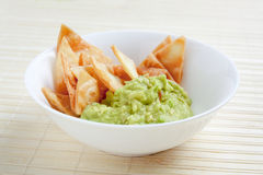 Bowl with guacamole and nachos Stock Image