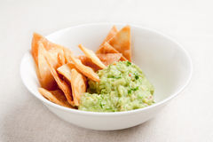 Bowl with guacamole and nachos Stock Photos