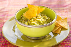 Bowl of Guacamole and nachos, sun light Royalty Free Stock Images