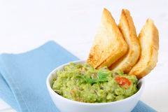 Bowl of guacamole with toasts Royalty Free Stock Photography